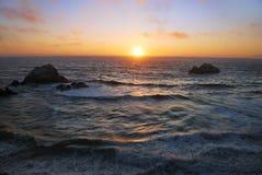 San Francisco Ocean Beach Sunset. Sunset above the wavy Pacific as seen from the Ocean Beach in San Francisco, California Stock Photos