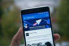 Facebook explore feed on mobile phone. San Francisco, october 10, 2017: New second facebook timeline explore feed on mobile phone Royalty Free Stock Photo
