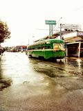 San Francisco old bus. On Wet street old green classic passenger bus street view 60s style Stock Photography