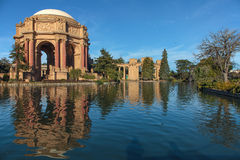 San Francisco Palace of Fine Arts. Palace of Fine Arts museum building and rotunda in San Francisco, California, reflected in the pond in early morning sunlight Stock Image