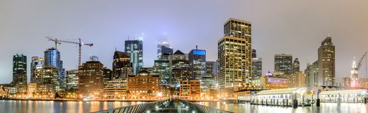 San Francisco Panoramic Skyline in foggy skies as seen from Pier 14. San Francisco Skyscrapers viewed from the port of  San Francisco, California, USA stock images