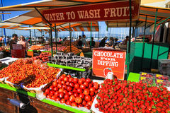San Francisco Pier 39 Farmer's Market Fruit Stand. Summer crowds check out the fresh fruit and other items available at the Farmer's Market on Pier 39, located Royalty Free Stock Images