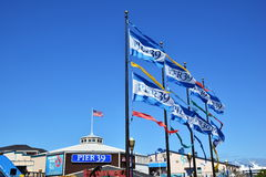 San Francisco Pier 39. SAN FRANCISCO, USA - MAY 08, 2016: San Francisco Destination Pier 39 Sign and flags, United States Flag Stock Photography