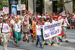 San Francisco Pride Parade Straights for Gay Rights Group. A Straights for Gay Rights group walking in the 2013 San Francisco Gay Pride parade, the largest in stock photo