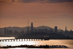 San Francisco`s Financial District new skyline at sunset. San Francisco`s Financial District new skyline as seen at sunset from across the bay royalty free stock photo