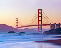 San Francisco's Golden Gate Bridge at Dusk. Brilliant blurred water and a pastel sky frame the Golden Gate Bridge at Sunset Royalty Free Stock Photos