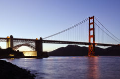 San Francisco's Golden Gate Bridge at Dusk. View of the southern anchorage of the Golden Gate Bridge at dusk Royalty Free Stock Image