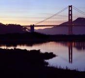 San Francisco's Golden Gate Bridge reflected at dusk. The Golden Gate Bridge and a dusk sky are reflected in Crissy's Field's Tidal Marsh in San Francisco Royalty Free Stock Image
