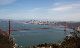 San Francisco's Golden Gate with city in background. From the Marin Headlands the Golden Gate bridge seems to hold the city of San Francisco on a beautiful day Royalty Free Stock Image