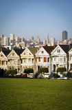 San Francisco scene. The famous San Francisco scene from Alamo square with row houses (Painted Ladies) in front and Financial District skyscrapers in back on a Stock Image