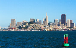 San Francisco Skyline from Bay Bouy. A green and red navigational bouy creates an interesting sense of scale in this late afternoon shot of the San Francisco Royalty Free Stock Images