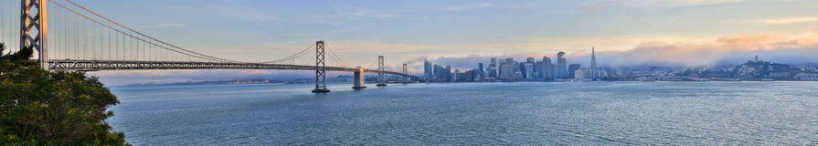San Francisco Skyline and Bay Bridge Panoramic View. San Francisco-Oakland Bay Bridge and San Francisco skyline from Treasure Island royalty free stock images