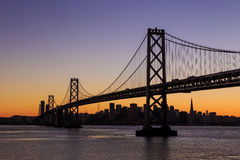 San Francisco skyline and Bay Bridge at sunset, California Royalty Free Stock Images