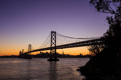 San Francisco skyline and Bay Bridge at sunset, California Stock Photo