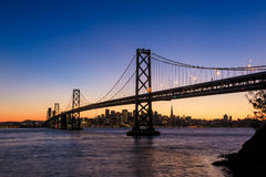 San Francisco skyline and Bay Bridge at sunset, California Stock Photos