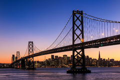San Francisco skyline and Bay Bridge at sunset, California Stock Image