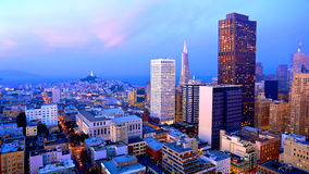 San Francisco Skyline at Dusk. San Francisco cityscape with colorful clouds at dusk stock photography
