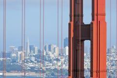 San Francisco skyline through Golden Gate. San Francisco skyline through a detail of Golden Gate bridge Royalty Free Stock Photography