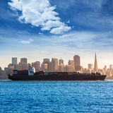 San francisco Skyline with merchant ship cruising bay at Califor Stock Photo