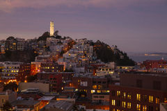 San Francisco Skyline at night. San Francisco Skyline (Telegraph Hill) at night, with the Coit Tower prominently in view and the San Francisco Bay in the Stock Image