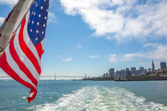 San Francisco skyline by sea. San Francisco Financial District skyline and Oakland Bridge on sunny day, California, United States. Sea views from the ship to Stock Photos