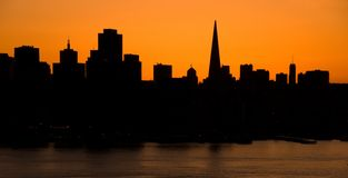 San Francisco Skyline at sunset. San Francisco skyline silhouette. A warming filter was used to enhance the warm orange sky from the setting sun. Photo taken Stock Photos