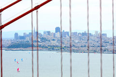 San Francisco skyline viewed through Golden Gate bridge cables Royalty Free Stock Photo