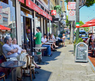 San Francisco street scene on a sunnu, summer morning. People are sitting outside cafes on Columbus Avenue in Little Italy enjoying breakfast on a sunny, summer Royalty Free Stock Image