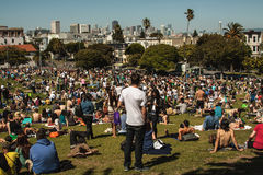 San Francisco summer afternoon people enjoying the day. San Francisco Delores park on a summer breeze day with the view of the city Royalty Free Stock Images