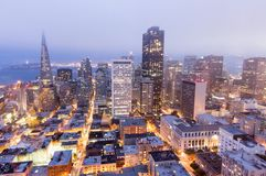 San Francisco Downtown in the fog at dusk. Royalty Free Stock Photos