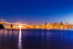 San Francisco sunset skyline California bay water reflection Royalty Free Stock Images