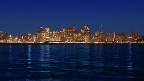 San Francisco sunset skyline in California with reflection in bay water stock footage