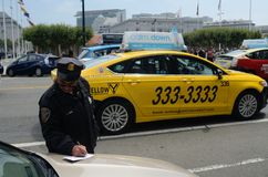 San Francisco Taxi Cab Protest. San Francisco driver getting a parking ticket during San Francisco taxi driver protest at city hall Stock Photo