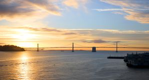 San Francisco to Oakland Bay Area Bridge. Sunrise silhouette of bridge. California, USA. San Francisco to Oakland Bay Area Bridge. Sunrise silhouette of Bay stock image