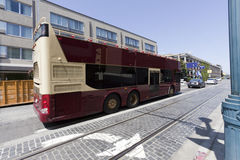 San Francisco Tour Charter Bus. Side and rear view of parked tour charter bus along San Francisco's Fishermans Wharf Stock Image