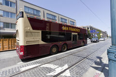 San Francisco Tour Charter Bus. Side and rear view of parked tour charter bus along San Francisco's Fishermans Wharf Royalty Free Stock Image