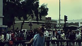 Cable Car juggler. San Francisco, United States - in 1980: juggler entertaining tourists at the main stop of Cable Car of San Francisco, Powell-Hyde lines stock video