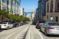 San Francisco, UNITED STATES - MAY 8, 2016: Streets of San Francisco Cityscape at Downtown with cars, cable car, San Francisco, Ca Royalty Free Stock Photography