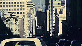 Vintage Cable Car California street. San Francisco, United States - in 1980: Restored archival footage in the 1980s of the red cable car in San Francisco stock footage