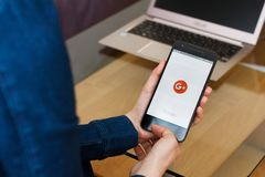 SAN FRANCISCO, US - 22 April 2019: Close up to female hands holding smartphone using Google plus for G Suite application, San. Francisco, California, USA. An stock photo