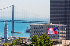 San Francisco USA American Flag Bay Bridge and Clock tower Stock Images