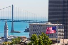 San Francisco USA American Flag Bay Bridge and Clock tower Stock Images