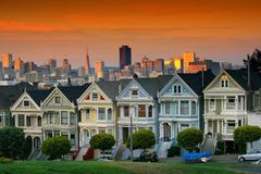 Victorian houses at dusk, San Francisco, USA. SAN FRANCISCO, USA - AUGUST 29, 2007: View of the painted ladies & x28;Victorian houses& x29; and urban city Royalty Free Stock Photo