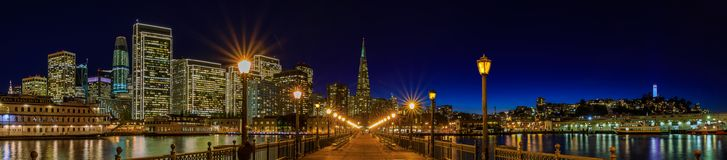 Downtown San Francisco and the Transamerica Pyramid at Chrismas. San Francisco, USA - November 27, 2017: Panoramic view of the Embarcadero Buildings, decorated Royalty Free Stock Photos
