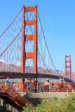 San Francisco, USA - October 8: People ride bicycle with a Golden Gate bridge in the background on October 8, 2011 in San Franci Royalty Free Stock Image