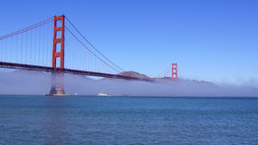 SAN FRANCISCO, USA - OCTOBER 5th, 2014: Golden Gate Bridge with heavy mist or fog as seen from Fort Point royalty free stock photos