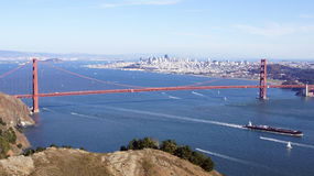 SAN FRANCISCO, USA - OCTOBER 4th, 2014: Golden Gate Bridge with SF city in the background and a ship passing, from Marin Headlands Royalty Free Stock Photography