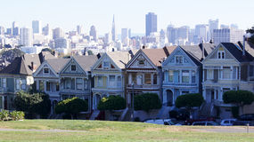 SAN FRANCISCO, USA - OCTOBER 5th, 2014: Painted Ladies with SF skyline in the background as seen from Alamo Square royalty free stock photos