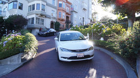 SAN FRANCISCO, USA - OCTOBER 5th, 2014: vehicles drive downhill on Lombard Street, most famous landmark and crookedest in world Stock Images