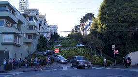 SAN FRANCISCO, USA - OCTOBER 5th, 2014: vehicles drive downhill on Lombard Street, most famous landmark and crookedest in world Stock Photography